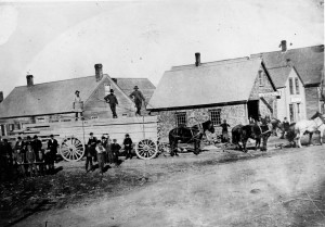 A lumber wagon and its horses