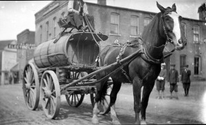 A horse drawn water wagon on Monroe Street near Algar's Cleaners (near Mercier's salon today).