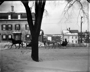 Sleighs on Main Street near Holmes Cottage in 1894. The Charles Hotel is across the street.