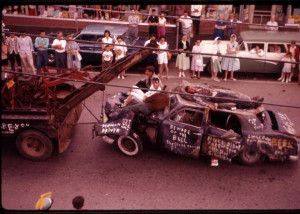 "During the Frontier Week parades, wrecks were towed around showing the dangers of poor driving. This one from 1961 cautions ""Beware of the Bull""."