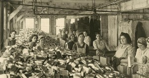 CARTONING SARDINES! Detailed wide view photo in our collections showing workers filling carton boxes with canned sardines. The location is the B.H. Wilson sardine factory in Eastport, Maine. We're guessing the photo dates to the 1940s. It's one of a series of same size photos of the factory taken at the same time that are in our collections.