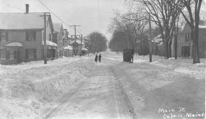 snow street car tracks horse and buggy walking on tracks holmestead